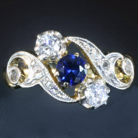 Curly late Victorian early Art Nouveau diamonds and sapphire engagement ring