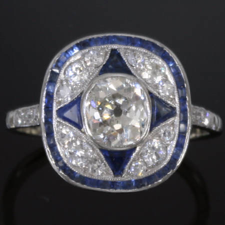 Original Art Deco platinum engagement ring with cushion cut diamond and sapphires