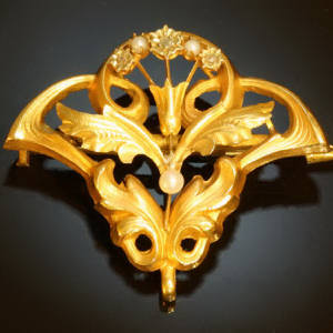 Golden Art Nouveau brooch and pendant with thistle motive