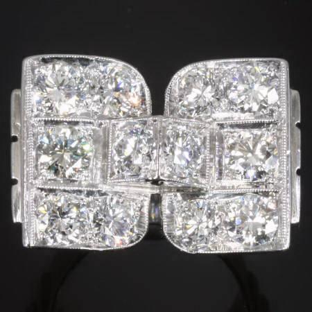 Solid platinum Retro ring with high quality brilliant cut diamonds