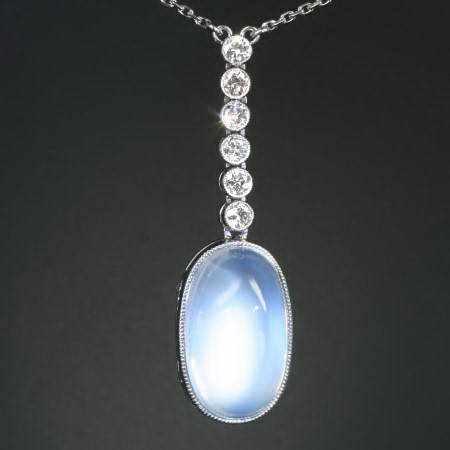 Platinum Art Deco diamond pendant with huge magnificent moonstone