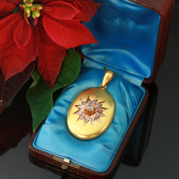 Magnificent two tone gold Victorian locket with rose cut diamond star motif