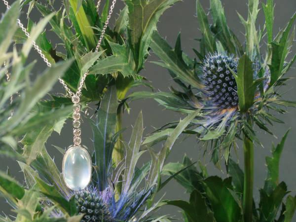 Platinum Art Deco diamond pendant with huge magnificent moonstone