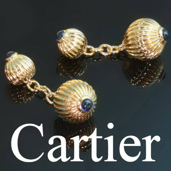 Estate cufflinks by Cartier, gold set with cabochon sapphires