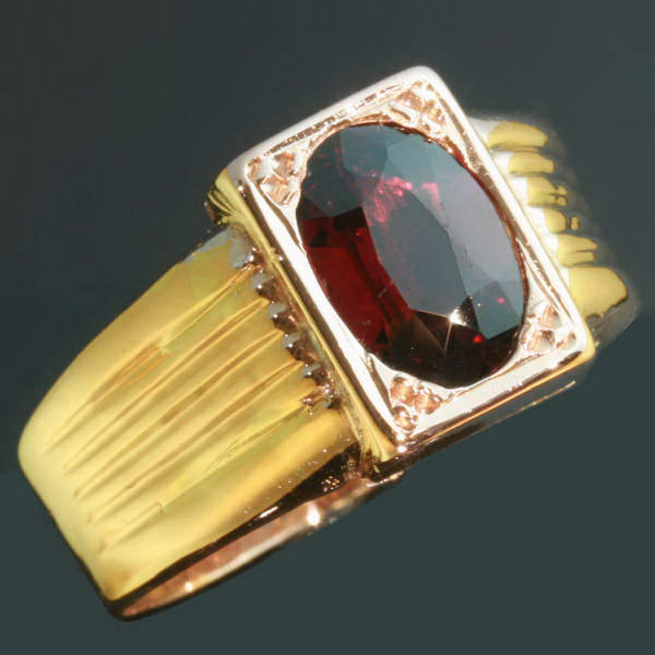 Gold Victorian ring set with garnet and with hidden space that can be closed
