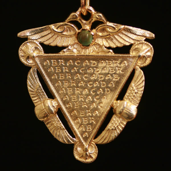 Victorian pendant in neo-Egyptian style with esoteric abracadabra text by Victor Hugo