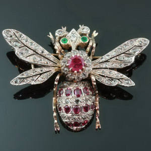 Antique brooches between $1500 and $5000