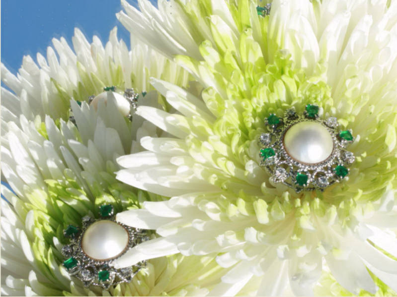 Impressive white gold earclips with diamonds, emeralds and big blister pearls from the antique jewelry collection of Adin Antique Jewelry, Antwerp, Belgium