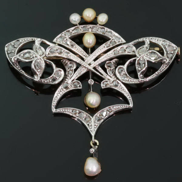 Antique Victorian brooches between $500 and $1500