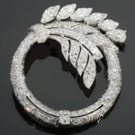 Truly magnificent Art Deco platinum diamond brooch from the antique jewelry collection of www.adin.be