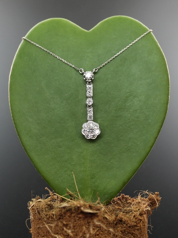 Art Deco platinum diamond set pendant on platinum chain from the antique jewelry collection of www.adin.be
