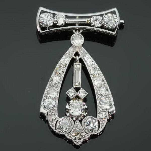 Rich estate art deco diamond pin brooch with diamond pendant hanging down from the antique jewelry collection of www.adin.be