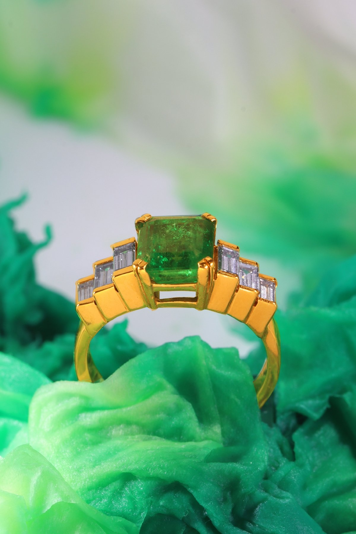 Click the picture to get to see this Vintage French estate ring with high quality Colombian emerald and baguette diamonds.