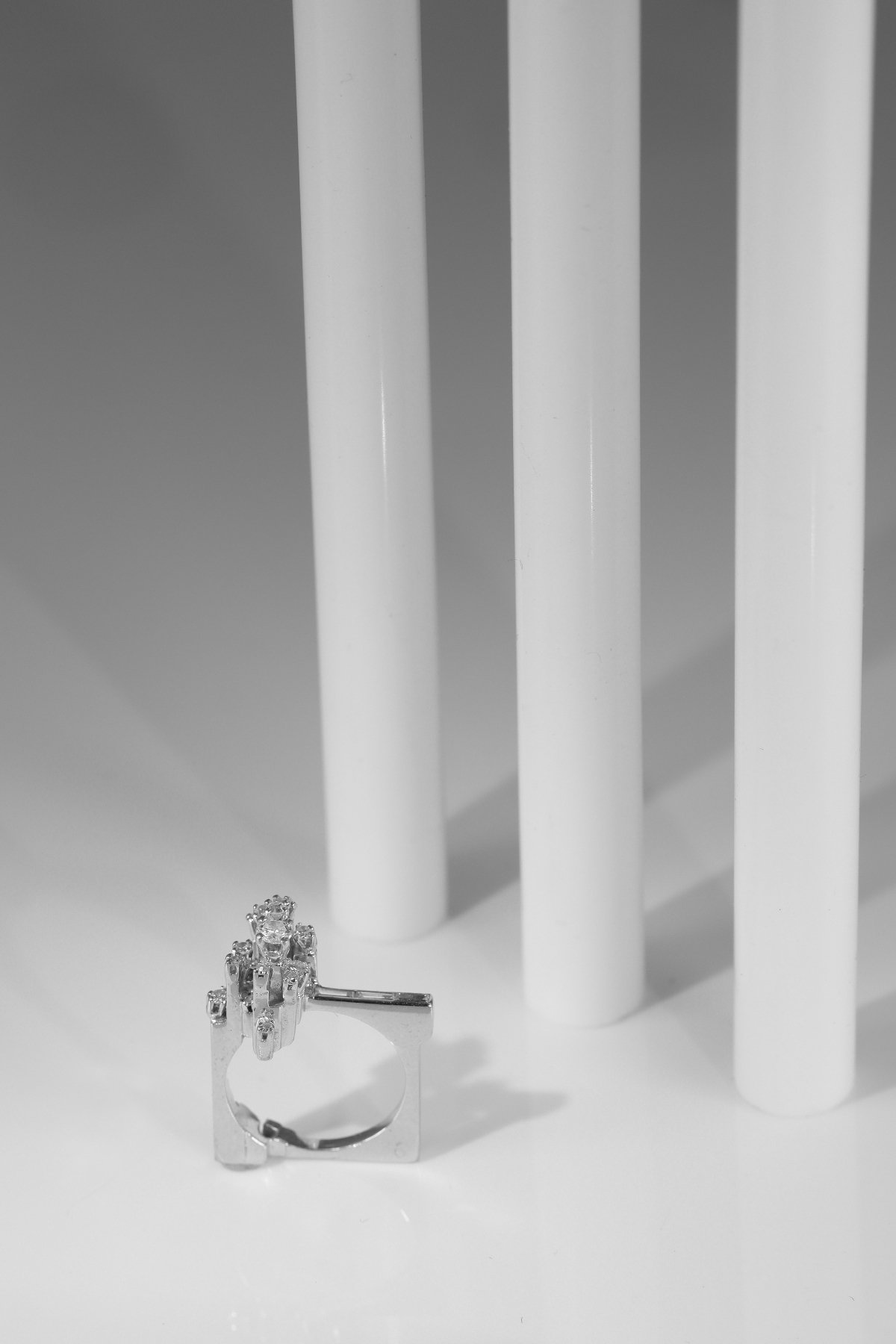 Click the picture to get to see this Vintage Sixties strong design artist jewelry French platinum ring with diamonds.