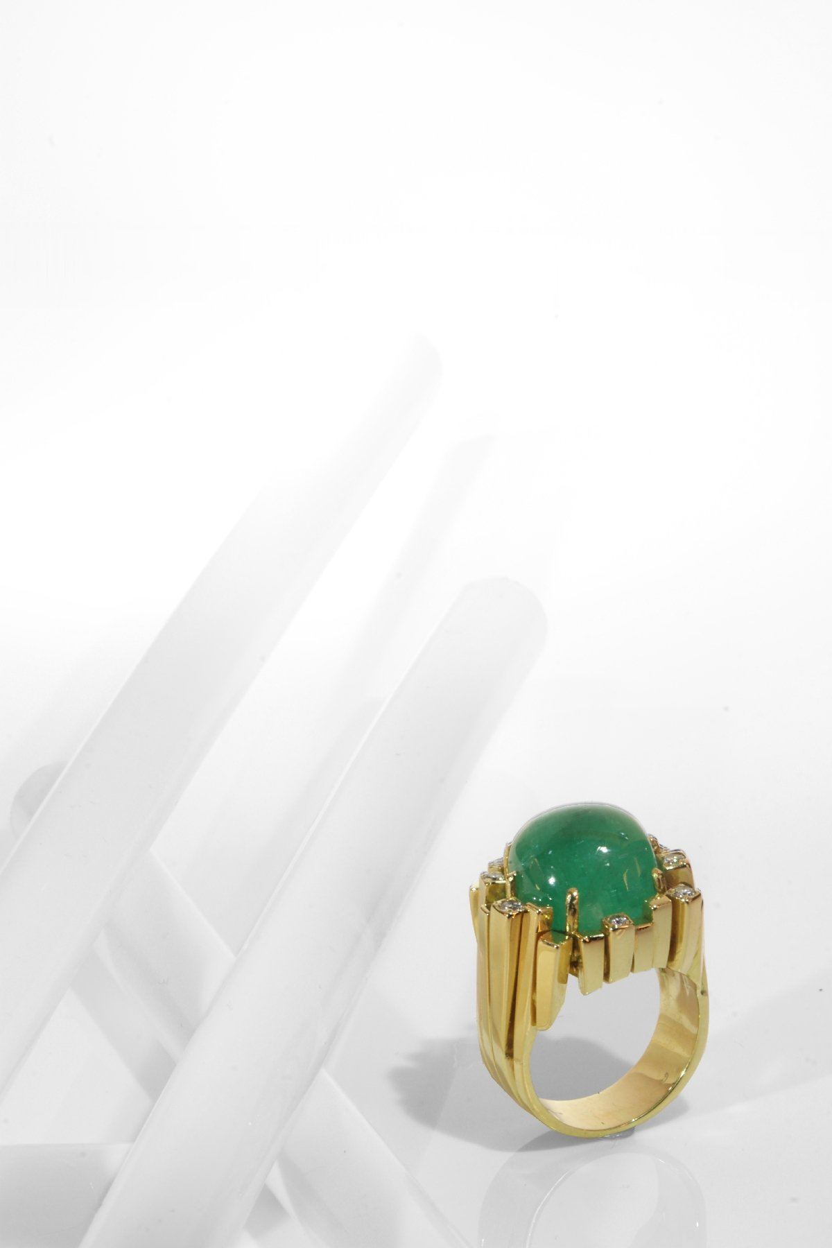 Click the picture to get to see this Seventies Modernistic Artist Design ring with large emerald and diamonds.