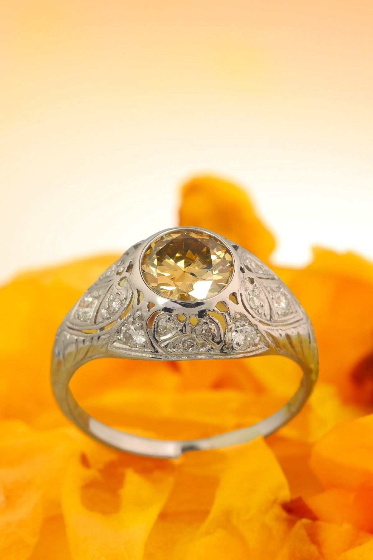 Click the picture to get to see this Vintage Fifties Art Deco engagement ring with natural fancy colour brilliant