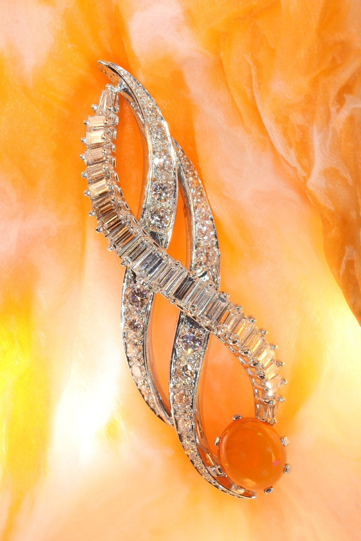 Click the picture to get to see this Vintage 1960's burning flame pendant with fire opal and diamonds.